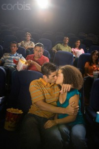 Couple Kissing in Theatre