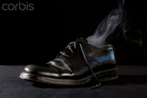 Smoke coming from a leather shoe