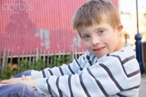 Close up portrait of boy sitting outside