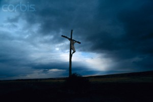 Crucifix Silhouetted Against Dark Skies