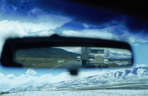 Road train reflection in rear view mirror, winter, USA