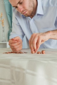 Desperate businessman counting his small change