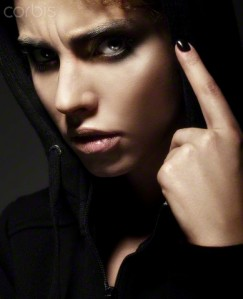 Studio shot of female in black, pointing finger