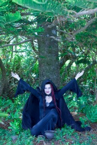 Woman Performing Pagan Ritual in Woods --- Image by © 68/Ocean/Corbis
