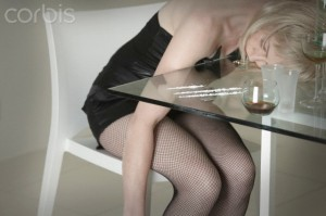 Woman unconscious alongside drugs and drink --- Image by © 145/Andrew Bret Wallis/Ocean/Corbis