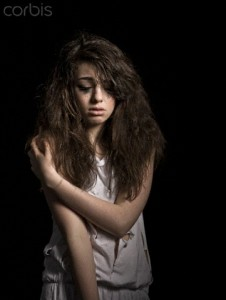 Crying girl with messy hair --- Image by © Alan Graf/cultura/Corbis