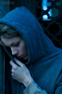 22 Oct 2013 --- Woman keeping warm in hooded sweartshirt --- Image by © Frederic Cirou/PhotoAlto/Corbis
