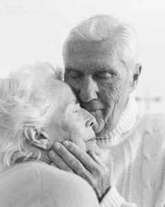 Elderly Man Touching Wife's Face --- Image by © Ronnie Kaufman/CORBIS