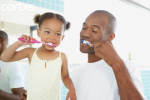 Father and daughter brushing their teeth together --- Image by © Tomas Rodriguez/Corbis