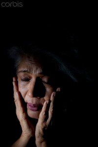 Old woman feeling depressed --- Image by © India Picture/Corbis