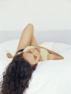 Close-up of a Young Woman Lying on Back --- Image by © 68/George Doyle/Ocean/Corbis
