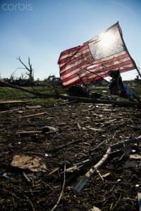 18 Nov 2013, USA --- American flag in debris after tornado --- Image by © Greg Vote/Tetra Images/Corbis