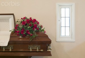 Flower arrangements on top of open coffin --- Image by © 2/Chris Thomaidis/Ocean/Corbis