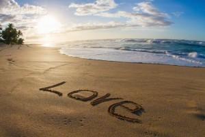 07 Dec 2014, Hawaii, USA --- Love, written in sand, sunset --- Image by © Philip Waller/Corbis