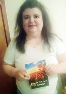 Joanna Maharis with her book